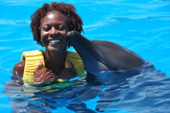 June 2012 - My first kiss by a dolphin! In spite of being in water all day, my curls are still poppin!