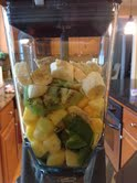 Kiwi, mango, pineapple, banana, spinach, avacado, flax seed, water, and ice, all waiting to be blended!