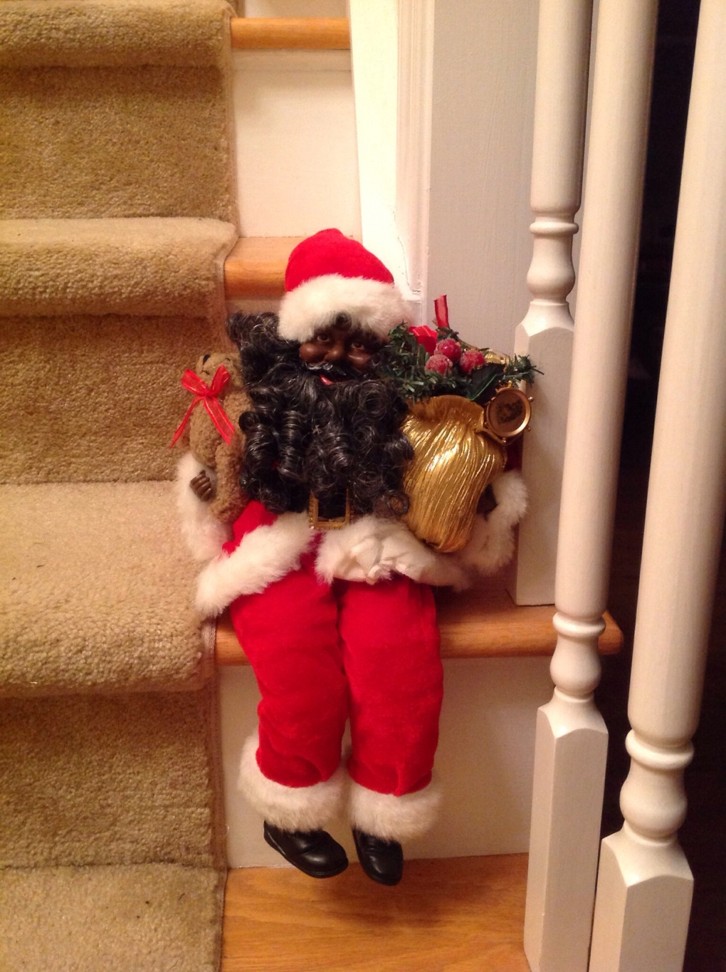 One of several Santa's that rests on the staircase.