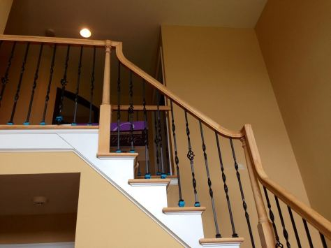 Yay!! The white balusters are gone!
