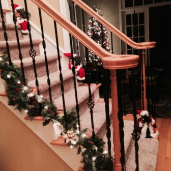 Santas chillin on the front steps. Lol