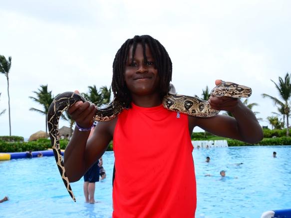 tailor holding snake